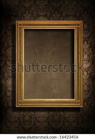 Dark, grungy wall with Victorian wallpaper and gold frame