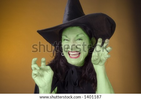 dark hair witch in costume - stock photo