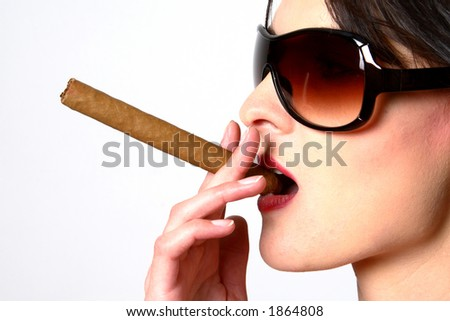 Dark hair woman smoking a cigar with sunglasses with white background - stock photo