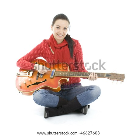 dark hair young woman playing electric guitar - stock photo