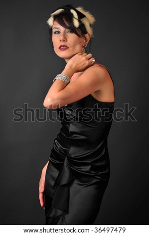 dark haired woman in fur hat - stock photo
