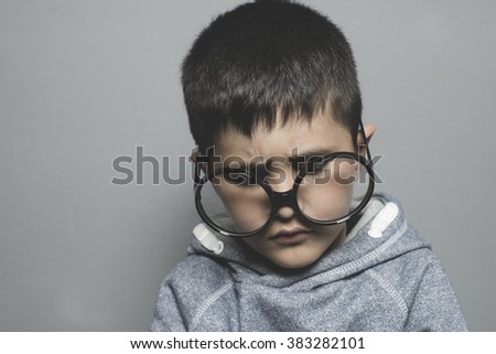dark-haired young student with big glasses thinking gesture