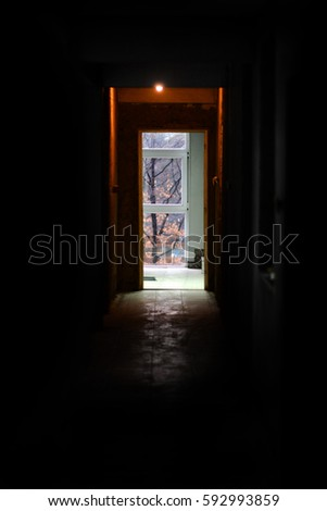 Dark Hallway. Diffused Light That Emanates From The Window Of A Corridor.  Exit Concept
