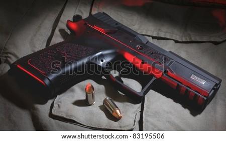 Dark handgun - stock photo