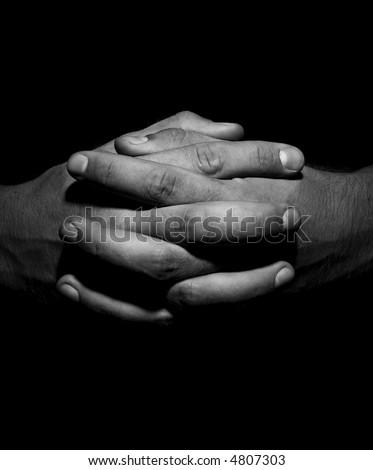 dark hands crossed - stock photo