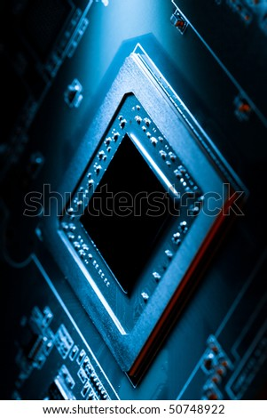 Dark high technology electronics computer component illuminated by spot of light. Innovation concept - stock photo