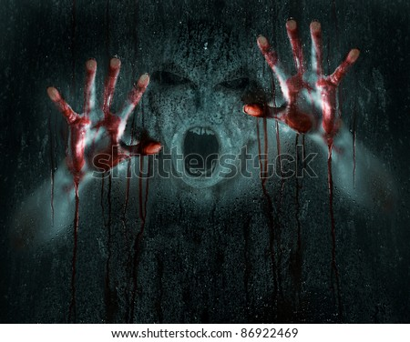 Dark Horror Scene of a Demon or Zombie with Bloody Hands against Icy Wet Glass - stock photo