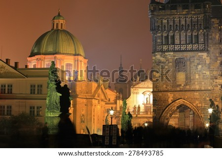 Dark image of Baroque churches and old Gothic tower surrounded by mist, Prague, Czech Republic - stock photo