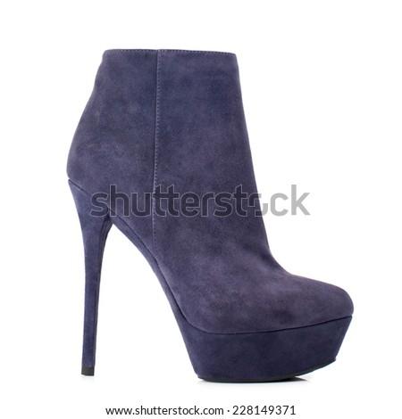 Dark indigo suede boot isolated on white background.  - stock photo