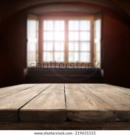 dark interior with window and table  - stock photo