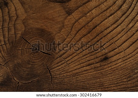 Dark knotted wood background - stock photo