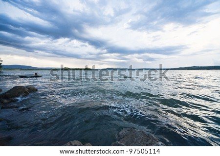 dark lake with clouds - stock photo