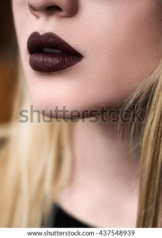 dark lips of a beautiful girl close-up