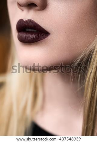 dark lips of a beautiful girl close-up - stock photo