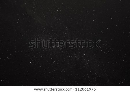 Dark matter inside the Milky Way and a distant galaxy in widefield astro image - stock photo
