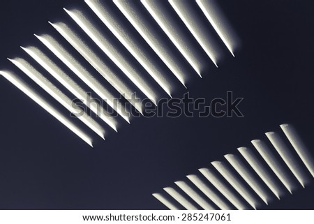 Dark metal industrial wall with ventilation grille, closeup photo with selective focus and shallow DOF - stock photo