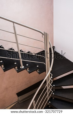 Dark modern staircase in the house, vertical - stock photo