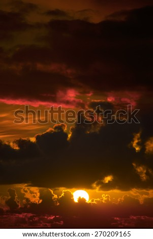 dark moody orange sunset sky in the wild atlantic way - stock photo