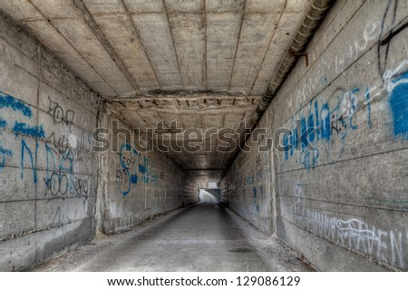 dark narrow underpass - dirty decadent tunnel in the old town  - stock photo
