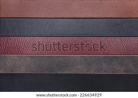 Dark natural leather belts close-up texture background - stock photo