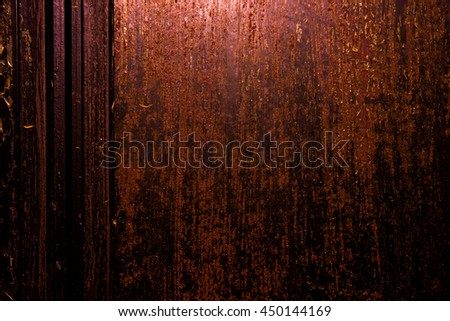 Dark old scary rusty rough golden and copper metal surface texture/background for Halloween or haunted house games background/texture of door or wall - stock photo