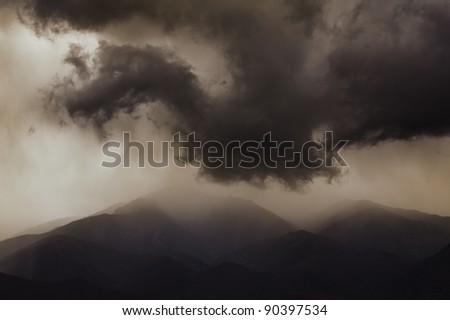 Dark ominous clouds. Dramatic sky. - stock photo