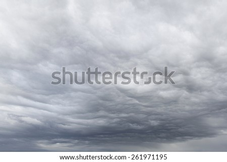 Dark ominous grey storm clouds - stock photo