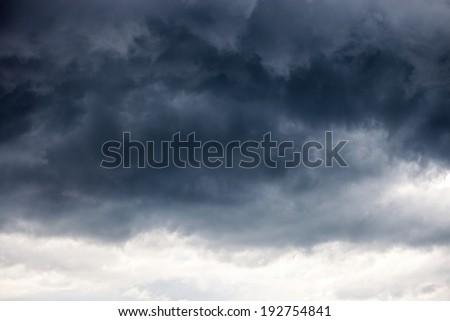 Dark ominous grey storm clouds - dramatic sky - stock photo