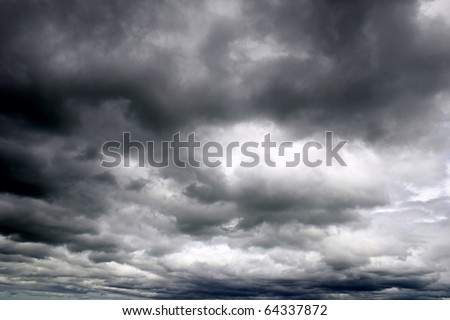 Dark ominous grey storm clouds. Dramatic sky. - stock photo