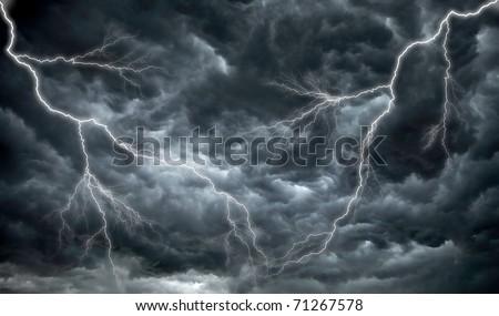 Dark, ominous rain clouds and lightening - stock photo