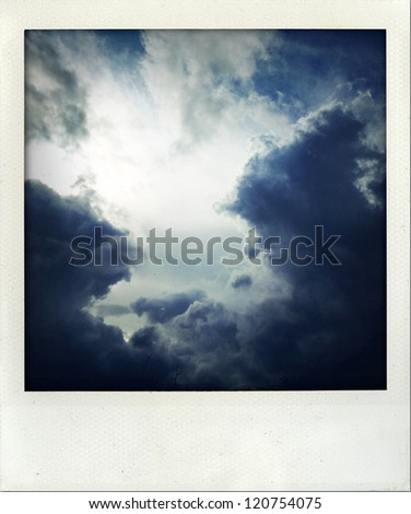Dark ominous storm clouds. Dramatic sky - stock photo