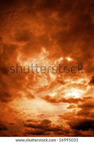 Dark orange cloudy sky at sunrise