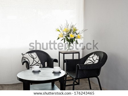 Dark outdoor furniture in a bright setting - stock photo