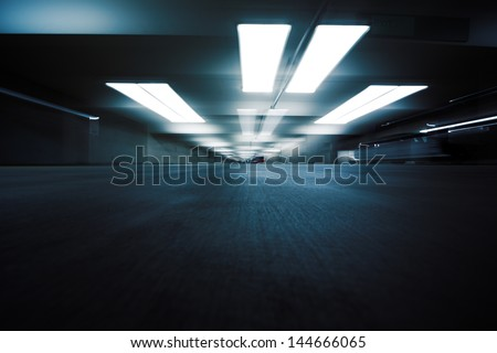 Dark parking garage industrial room interior. Zoom blur perspective. - stock photo