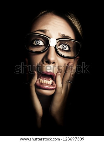 Dark Photograph On The Scared Face Of A Business Person Wearing Eye Glasses In A Depiction Of Stress And Fear - stock photo