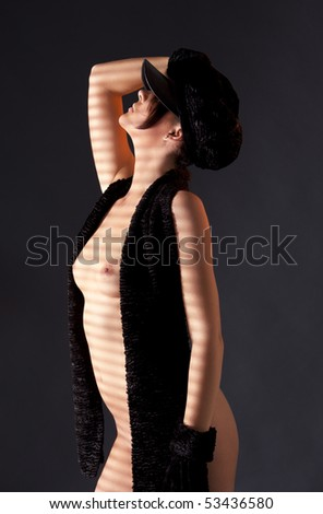 dark picture of sexy woman in black astrakhan - stock photo