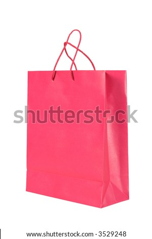 Dark pink shopping bag isolated on a white background. The bag a made from paper. The handles of the bag are visible - stock photo
