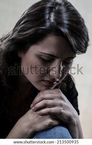 Dark portrait of beautiful crying woman, vertical - stock photo
