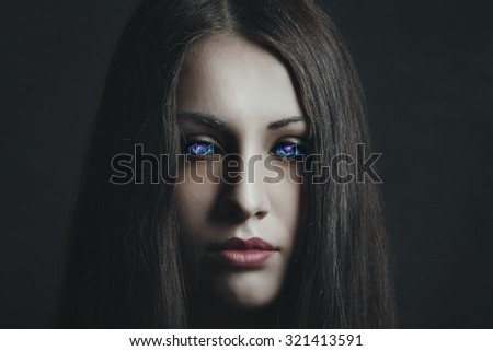 Dark portrait of beautiful girl with strange eyes. Surreal and alien  - stock photo