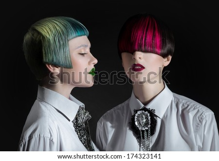 Dark portrait of pale gothic women with creatively dyed hair - stock photo