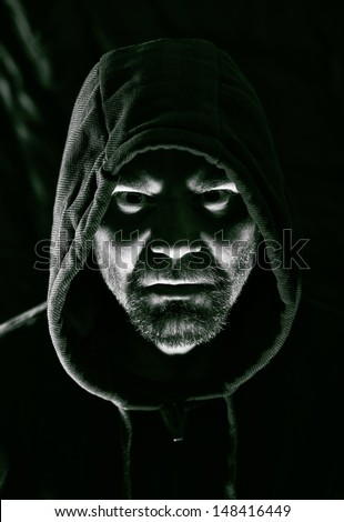 Dark portrait of scary evil sinister bearded man - stock photo