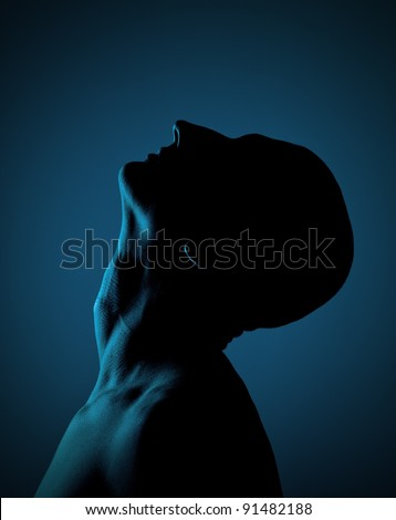 Dark profile of the mysterious bald person - stock photo