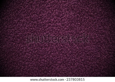 Dark purple fitted carpet background or texture - stock photo