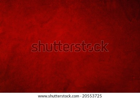 Dark red background fabric with soft folds and smudges in uneven candlelight. - stock photo