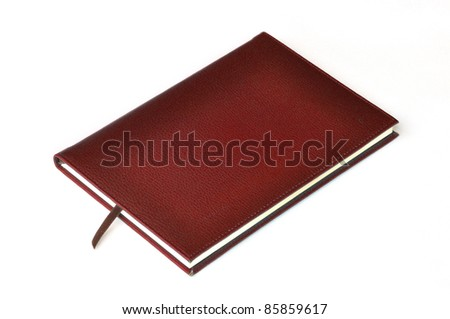 Dark red leather notebook on white background - stock photo