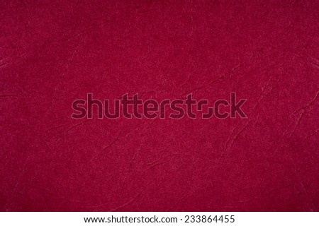 Dark red ragged cardboard texture abstract, paper plain grainy surface background in horizontal orientation, nobody. - stock photo