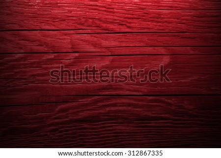 Dark red wooden background. - stock photo