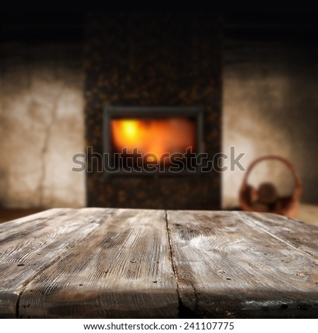 dark retro interior with fireplace and old table of wood