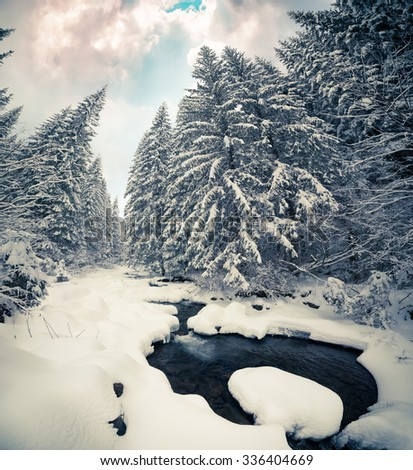 Dark river in the winter mountain forest. Retro style.