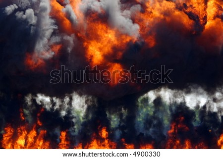Dark rolling smoke and fire rising from a large explosion - stock photo